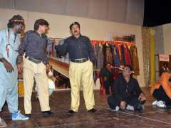 MULTAN: Artist performing on the stage play titled 'Pasban' during drama competition organized by Arts Council.