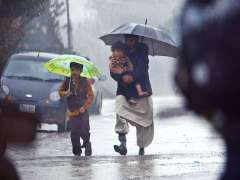 RAWALPINDI: A family on the way under cover of umbrella during a heavy rain that experienced the twin cities.