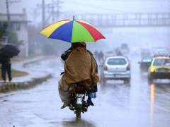 RAWALPINDI: A family on the way on a motorcycle under cover of an umbrella during heavy rain that experienced the twin cities.