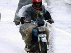 RAWALPINDI: Motorcyclists on the way during heavy rain that experienced the twin cities.