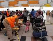 اسلام آباد، پاکستان میں پھنسے ہوئے جرمن شہریوں کو گھر لے کر جانے والی ..