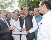 اسلام آباد: وزیراعظم کے معاون خصوصی ملک امین اسلم ، وائس چانسلر علامہ ..
