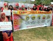 اسلام آباد: پاکستان ریڈ کریسنٹ سوسائٹی (پی آر سی ایس) کے رضاکار کورونا ..
