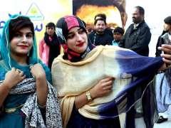 HYDERABAD:Visitors capturing the moments through cell phone during Salam Kisan Sarsabz Pakistan Mela at Sindh Museum.