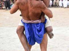 LARKANA:Wrestlers in action during traditional wrestling (Mulakhara) near Shrine of Hazrat Syed Miran Shah Bukhari during his of 50th annual urs celebrations.