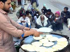 HYDERABAD:A vendor preparing traditional parathas for breakfast to sell to customers at his setup at Fort Road.