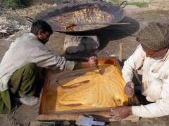 SIALKOT:Farmers preparing gur at their field.