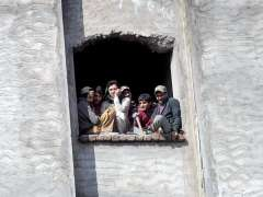 RAWALPINDI:Labourers looking out and enjoying a sunny day in an under construction building.