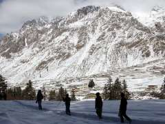 GILGIT:People enjoying skating after fresh snow fall in the area.