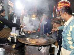 MULTAN:Vendors busy in making traditional food item at their workplace.