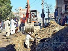 HYDERABAD:A view of labourers repairing the sewerage line on the road at Ghari Khata area.