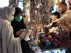 QUETTA:Female customers selecting and purchasing artificial jewellery at Chowri Gali Liaquat Bazaar for Eid shopping.