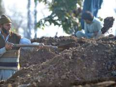 RAWALPINDI:Labourers digging the place to lay water pipelines near Chaklala Railways Station.
