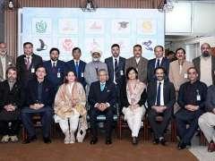 ISLAMABAD:President Dr. Arif Alvi in a group photo at Pakistan Bait-ul-Mal.