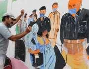 کراچی، لیاری ایس پی آفس کی دیوار پر آرٹسٹ عوام کی آگاہی کیلئے کورونا ..