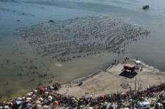 1941 افراد نے ارجنٹائن کی جھیل میں ایک لائن میں  تیر  کر نیا ورلڈ ریکارڈ ..