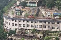 چونگ چنگ کی حیرت انگیز عمارتیں، جن کی چھتوں پر سڑکیں ہیں۔