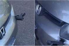 اڑتی ہوئی گن گاڑی کے بمپر میں پیوست ہوئی، ڈرائیور لاعلم