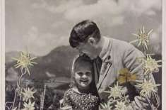A Signed Photo Of Hitler Embracing A Little Jewish Girl Just Sold For Over $11,000