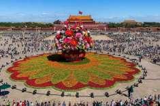 چین کے قومی دن کی آمد ر بیجنگ کو پھولوں سے سجانے کا کام جاری