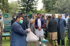 Former captain Shahid Afridi visits Afghan camp, distributes rations