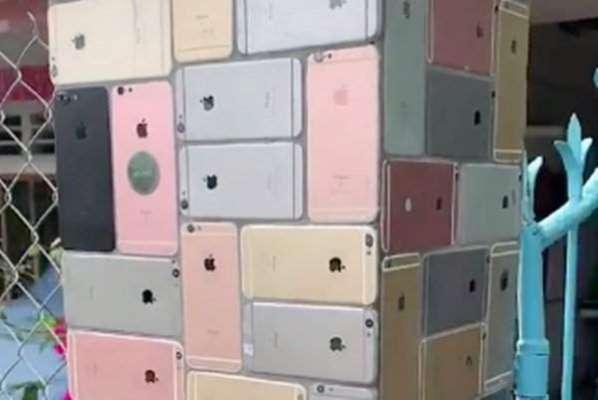 آئی فون کے شوقین نے  گھر کے جنگلے پرٹائلوں کی جگہ  سینکڑوں آئی فون  6 ..