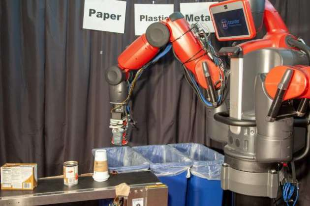 Recycling robot can sort paper and plastic by touch