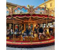 something about carousels that seems magical. maybe the bright colours, maybe the decorated horses coupled with faces of smiling children that make me want to go back in time.